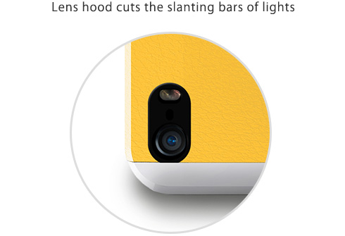 Lens hood cuts the slanting bars of lights