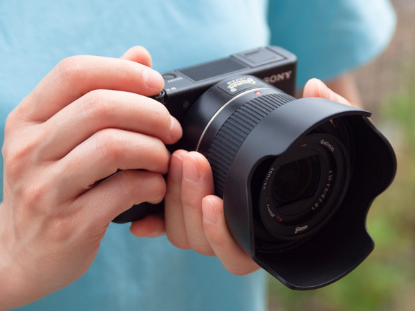 Could be handheld similarly as to how SLRs are held, which prevents camera shake.